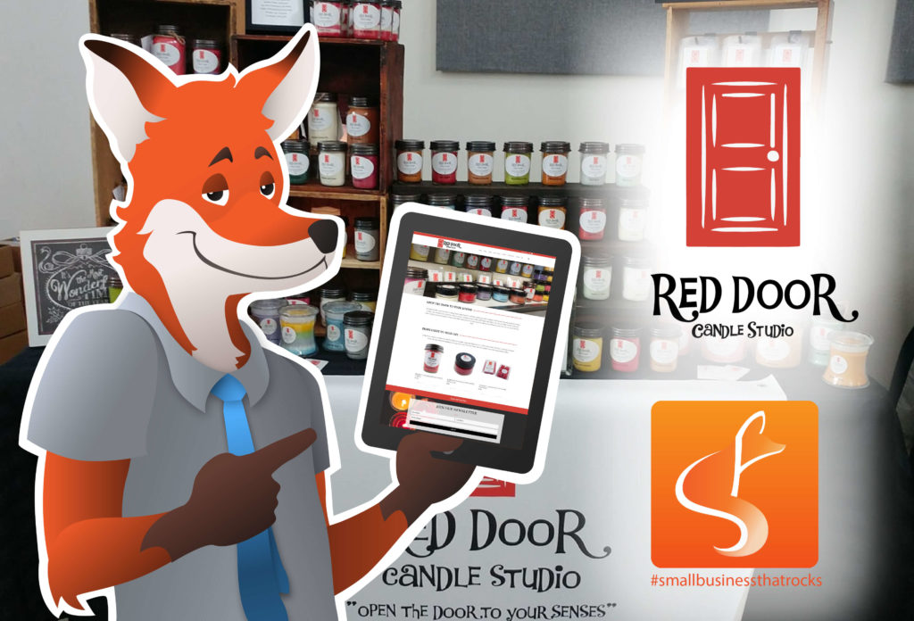 SlyFox Mascot pointing to screen displaying Red Door Candle Studio web page
