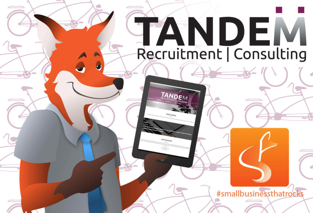 slyfox mascot holding tablet displaying tandem website