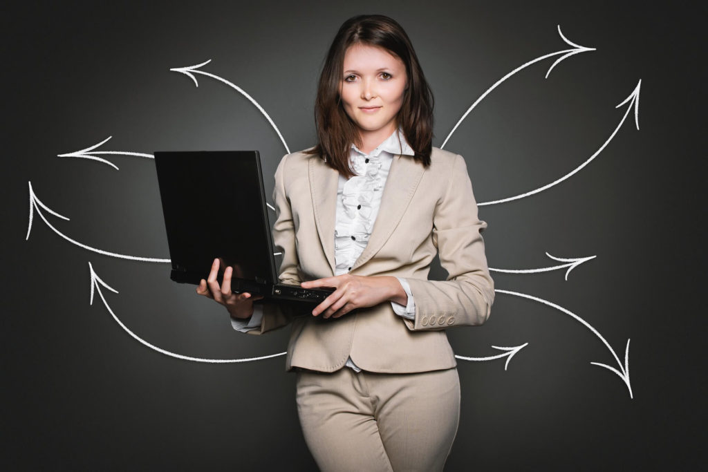woman holding laptop - SlyFox Web Design and Marketing