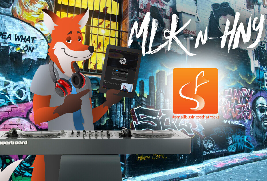 slyfox mascot holding tablet with mlknhny website - SlyFox Web Design and Marketing