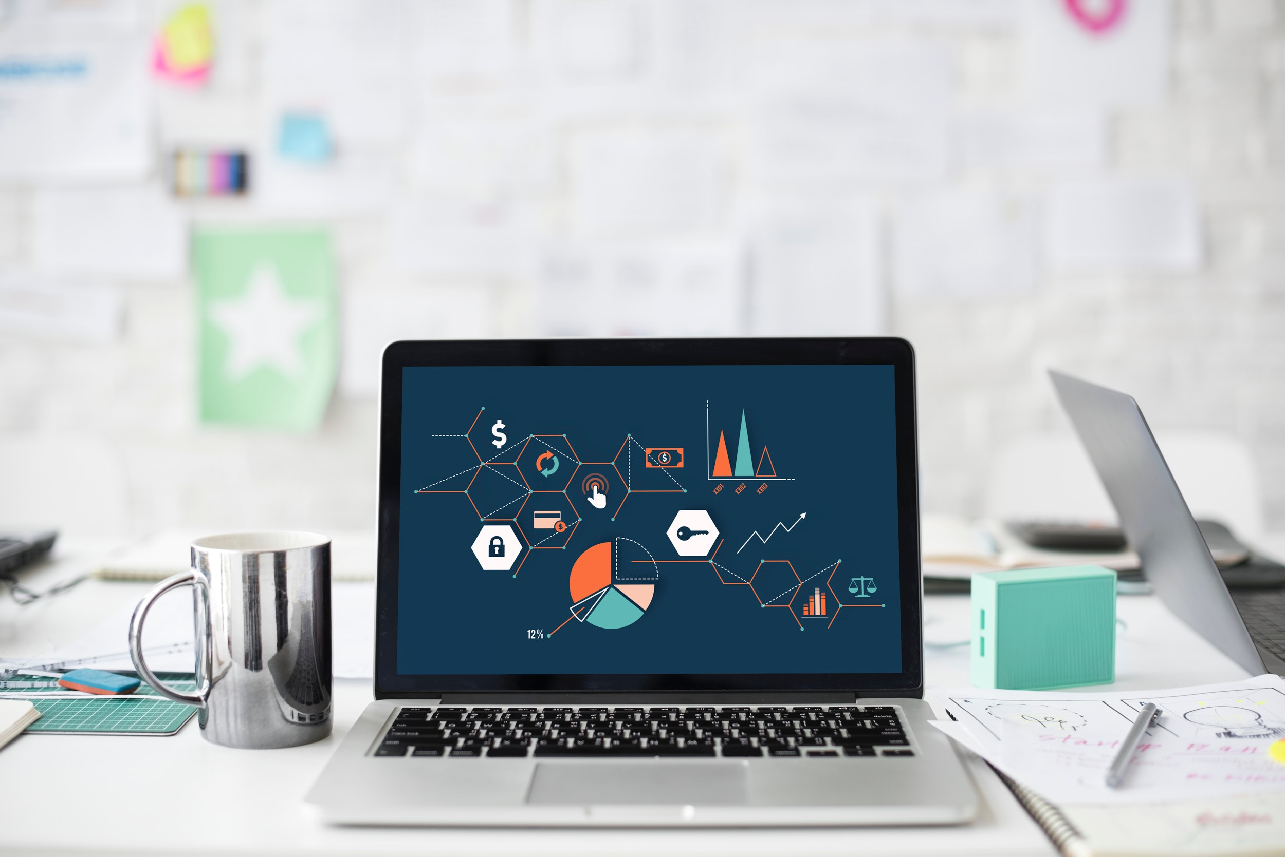 graphs and marketing images on macbook screen - SlyFox Web Design and Marketing