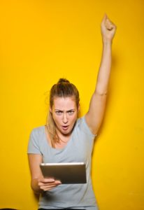excited woman with tablet - slyfox web design and marketing